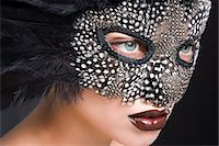 Woman wearing mask of feathers Stock Photo - Premium Royalty-Freenull, Code: 6114-06596475