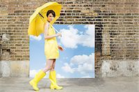 people with umbrellas in the rain - Young woman with umbrella and sky background Stock Photo - Premium Royalty-Freenull, Code: 6114-06596482
