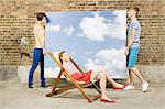 Young woman in deckchair and others with sky backdrop Stock Photo - Premium Royalty-Free, Artist: ableimages, Code: 6114-06596486