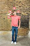 Teenage boy and arrows Stock Photo - Premium Royalty-Free, Artist: Westend61, Code: 6114-06596515