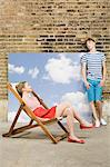 Teen couple with deckchair and sky backdrop Stock Photo - Premium Royalty-Free, Artist: Siephoto, Code: 6114-06596519