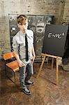 Teenage boy in room with blackboard Stock Photo - Premium Royalty-Free, Artist: Blend Images, Code: 6114-06596527