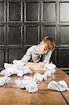Teenage boy with crumpled paper Stock Photo - Premium Royalty-Free, Artist: Robert Harding Images, Code: 6114-06596540