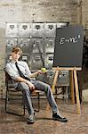 Teenage boy in room with blackboard Stock Photo - Premium Royalty-Free, Artist: Blend Images, Code: 6114-06596542