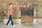 Teenage boy and row of arrows Stock Photo - Premium Royalty-Free, Artist: Westend61, Code: 6114-06596548