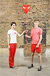 Young couple with heart shaped balloon Stock Photo - Premium Royalty-Free, Artist: ableimages, Code: 6114-06596552