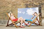 Young couple in deckchairs Stock Photo - Premium Royalty-Free, Artist: ableimages, Code: 6114-06596553