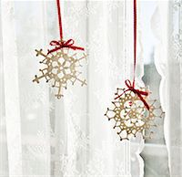 snowflakes  holiday - Snowflake decorations in window Stock Photo - Premium Royalty-Freenull, Code: 6114-06596708