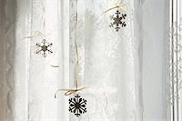 snowflakes  holiday - Snowflake decorations in window Stock Photo - Premium Royalty-Freenull, Code: 6114-06596728