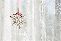 snowflakes  holiday - Snowflake decoration in window Stock Photo - Premium Royalty-Freenull, Code: 6114-06596745