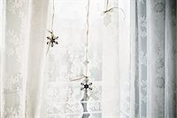 snowflakes  holiday - Snowflake decorations in window Stock Photo - Premium Royalty-Freenull, Code: 6114-06596749