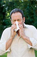 people coughing or sneezing - Man sneezing Stock Photo - Premium Royalty-Freenull, Code: 6114-06596806