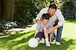 Father and son with a grazed knee Stock Photo - Premium Royalty-Free, Artist: Michael Mahovlich, Code: 6114-06596812