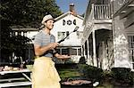 Man cooking on a barbecue Stock Photo - Premium Royalty-Free, Artist: CulturaRM, Code: 6114-06596960