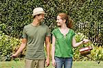 Couple watering a garden Stock Photo - Premium Royalty-Free, Artist: Ikon Images, Code: 6114-06596965