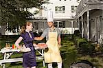Couple barbecuing in the garden Stock Photo - Premium Royalty-Free, Artist: Blend Images, Code: 6114-06596972