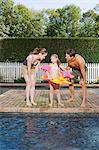Parents with daughter by the pool Stock Photo - Premium Royalty-Free, Artist: Uwe Umstätter, Code: 6114-06596975