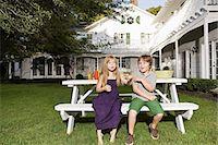people sitting on bench - Children sitting on a garden bench Stock Photo - Premium Royalty-Freenull, Code: 6114-06596980