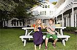 Children sitting on a garden bench Stock Photo - Premium Royalty-Free, Artist: Westend61, Code: 6114-06596980