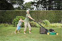 Father and son mowing the lawn Stock Photo - Premium Royalty-Freenull, Code: 6114-06596984