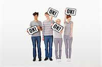 person holding sign - People holding signs that say ok Stock Photo - Premium Royalty-Freenull, Code: 6114-06597022