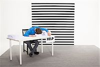 people in panic - Office worker with sign that says help Stock Photo - Premium Royalty-Freenull, Code: 6114-06597047