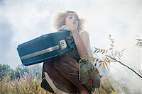 Girl with a suitcase Stock Photo - Premium Royalty-Freenull, Code: 6114-06597093