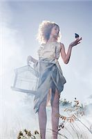 Girl with a bird and cage Stock Photo - Premium Royalty-Freenull, Code: 6114-06597100