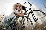 Girl with a bicycle Stock Photo - Premium Royalty-Free, Artist: I Dream Stock, Code: 6114-06597116