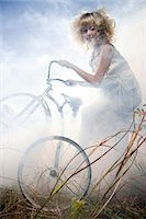 Girl with a bicycle Stock Photo - Premium Royalty-Freenull, Code: 6114-06597127