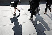 Businesspeople walking Stock Photo - Premium Royalty-Freenull, Code: 6114-06597160