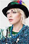 Young woman in a feathered hat Stock Photo - Premium Royalty-Free, Artist: Robert Harding Images, Code: 6114-06597233