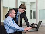 Businessmen with laptop Stock Photo - Premium Royalty-Free, Artist: Blend Images, Code: 6114-06597312