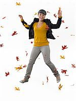 people falling - Young woman jumping amongst leaves Stock Photo - Premium Royalty-Freenull, Code: 6114-06597521