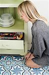 Young woman and drawer of cookies Stock Photo - Premium Royalty-Free, Artist: CulturaRM, Code: 6114-06597587