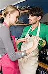Young couple in kitchen with wine Stock Photo - Premium Royalty-Free, Artist: Photocuisine, Code: 6114-06597638