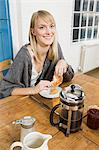 Young woman having breakfast Stock Photo - Premium Royalty-Free, Artist: Cultura RM, Code: 6114-06597640