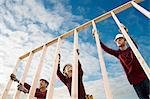 People with wooden construction frame Stock Photo - Premium Royalty-Free, Artist: Blend Images, Code: 6114-06597646