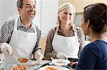 People volunteering at soup kitchen Stock Photo - Premium Royalty-Free, Artist: Cultura RM, Code: 6114-06597658