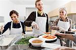People volunteering at soup kitchen Stock Photo - Premium Royalty-Free, Artist: Jean-Christophe Riou, Code: 6114-06597671