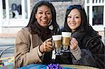Female friends having coffee Stock Photo - Premium Royalty-Free, Artist: Cultura RM, Code: 6114-06597792