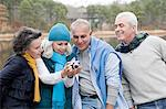 Four friends with camera Stock Photo - Premium Royalty-Free, Artist: Cultura RM, Code: 6114-06597935
