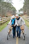 Mature couple with bicycles Stock Photo - Premium Royalty-Free, Artist: Blend Images, Code: 6114-06597960