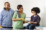 Family doing plumbing in kitchen Stock Photo - Premium Royalty-Free, Artist: Glowimages, Code: 6114-06597991