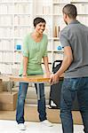 Couple carrying coffee table Stock Photo - Premium Royalty-Free, Artist: CulturaRM, Code: 6114-06598022