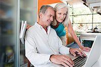 Couple using laptop Stock Photo - Premium Royalty-Freenull, Code: 6114-06598063