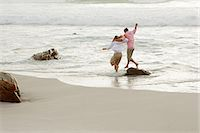 Couple having fun in the sea Stock Photo - Premium Royalty-Freenull, Code: 6114-06598089