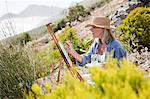 Artist painting on hillside Stock Photo - Premium Royalty-Free, Artist: Blend Images, Code: 6114-06598104