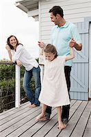 Family outside holiday home Stock Photo - Premium Royalty-Freenull, Code: 6114-06598170