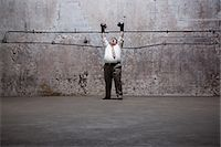 fat man full body - Man standing in warehouse Stock Photo - Premium Royalty-Freenull, Code: 6114-06598261